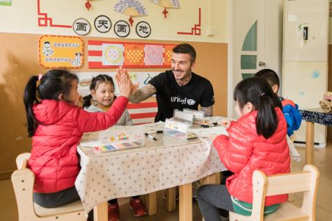 UNICEF Goodwill Ambassador and Global Icon David Beckham high fives with a girl during a visit to Xianghuaqiao Kindergarten on the outskirts of Shanghai, China, on 27th March 2019.