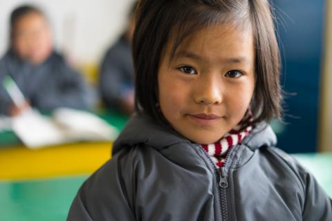 A girl in her classroom in DPR Korea