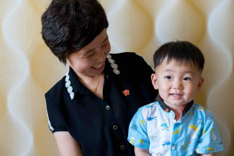 Mother and son in Jongju City, DPR Korea