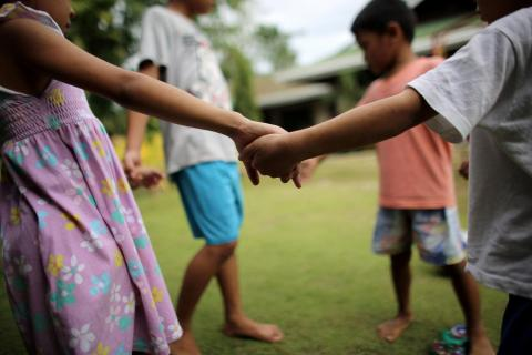 Children holding hands in the Philippines