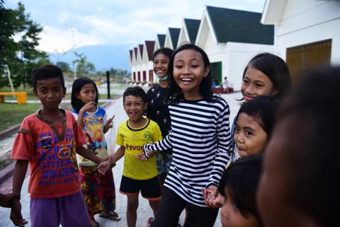 Sophia Angelica Majid, 11, plays with her friends in Talise Village in Central Sulawesi.