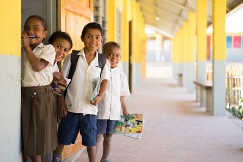 Children outside their UNICEF-supported school in Timor-Leste