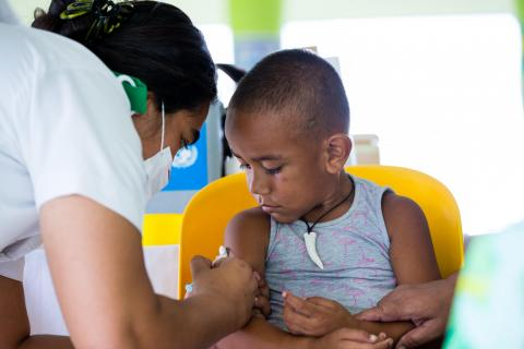 Four-year-old Talipope Wayne receives a measles vaccination in Leauvaa Village, as part of a UNICEF-supported National Vaccination Campaign