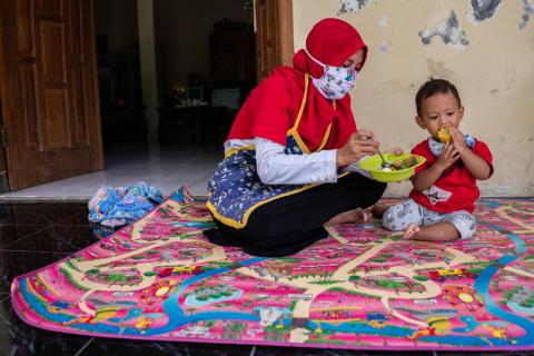Dini feeds her son Abdullah, 1, at their home in Paseban village, Central Java province, Indonesia