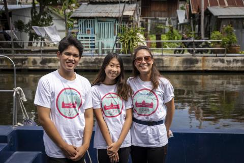 "Ralyn ""Lilly"" Satidtanasarn (centre) poses and other community volunteers pose for a photo as they work with sanitation workers to collect plastic waste from the canals in Bangkok, Thailand's capital city."
