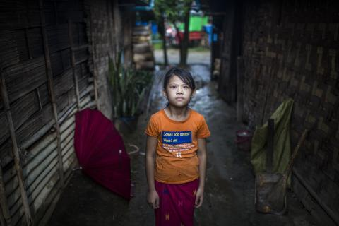 A girl looks at the camera in an IDP camp in Kachin State, Myanmar