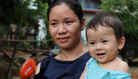 A mother with her baby in Laos