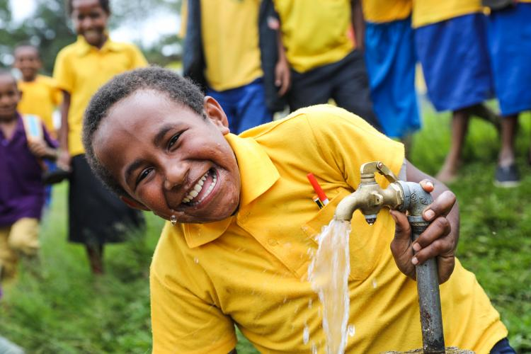 Ryan Kalowa, 11, is happy to see the return of safe drinking water at his School in Papua New Guinea.