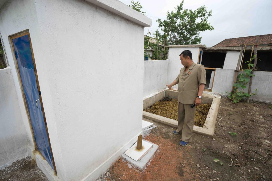 Ri In Ho explains how the new latrine and composting system works