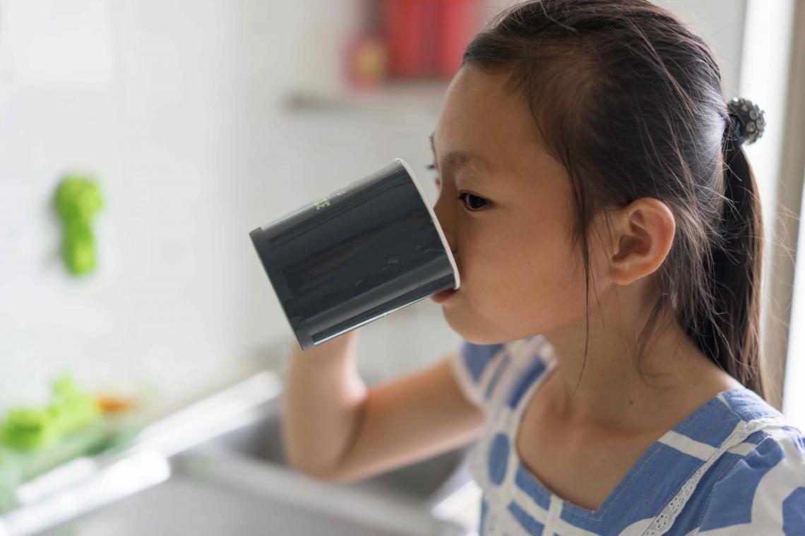 Yun Rye Yong, 10, drinks tapped water in her home