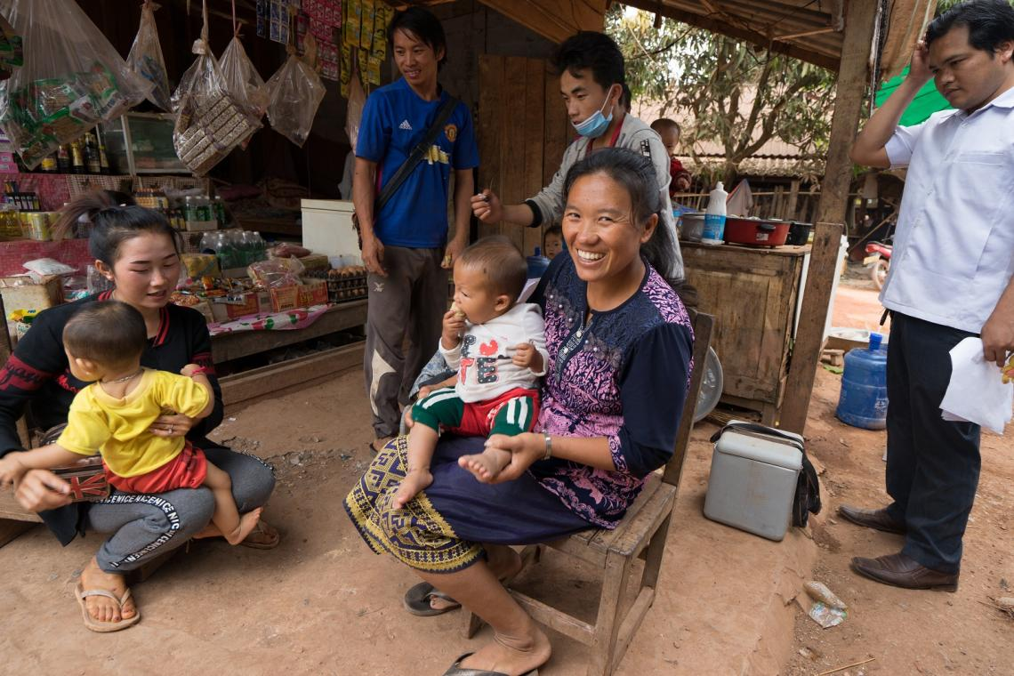 Mothers in a market in Non Hai, Vientiane Province, Lao PDR wait for their children to be vaccinated