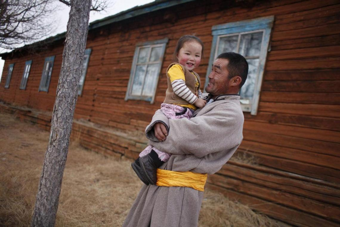 a father in Mongolia holds his daughter