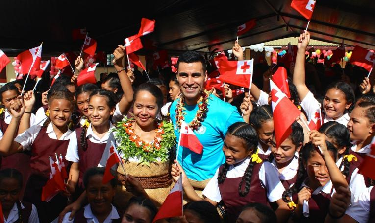 Pita Taufatofua with school students
