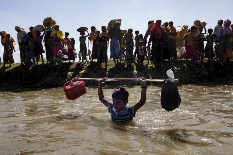 A group of 620 Rohingya refugees cross into Bangladesh from Myanmar