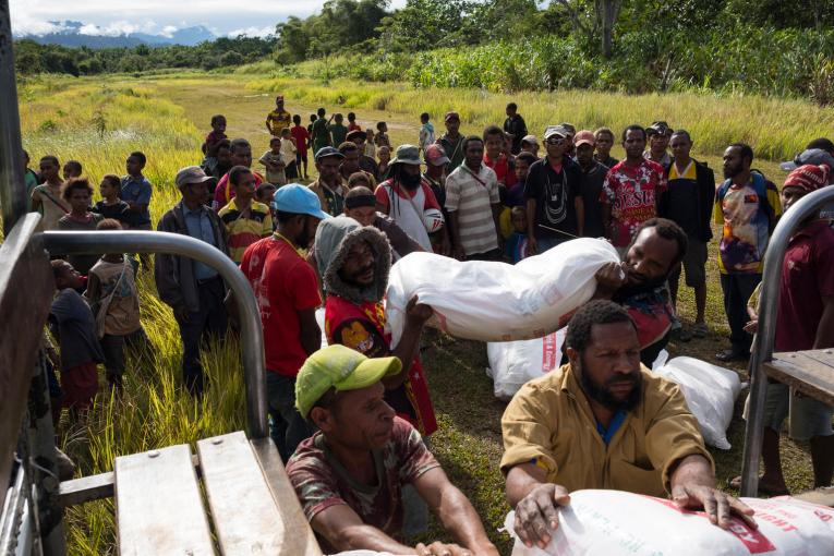 Food aid supplies delivered by helicopter for affected people