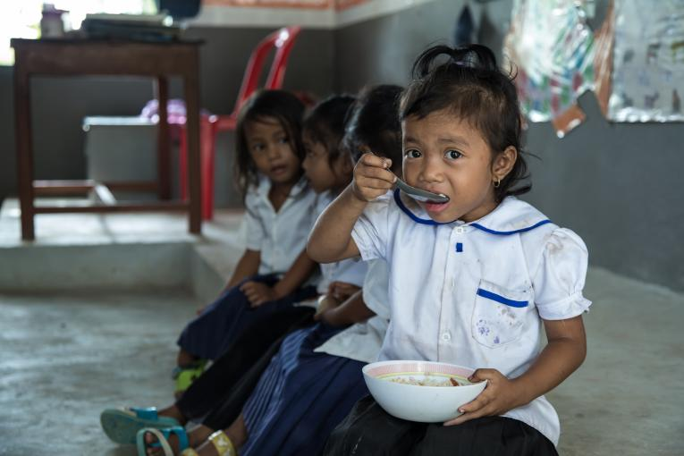 Phan Bopha eats her meal before her class
