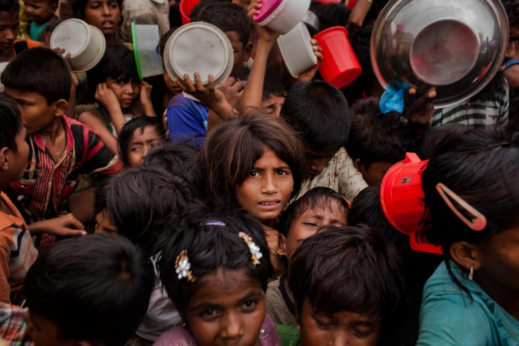 Thousands of Rohingya refugee children queue for aid at the Mainnerghona distribution center, Cox's Bazar