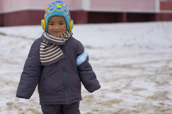 a child in UNICEF-supported warm weather clothes in Northern DPR Korea