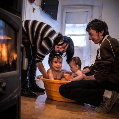 The Markovic family wash their children in a bath at their home in Bac, Serbia.