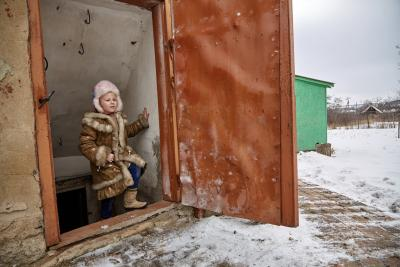 Sasha, 6, steps out of her cellar in eastern Ukraine where her, her sister, and their grandmother shelter when there is shelling.