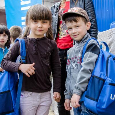 Two children with UNICEF backpacks on.