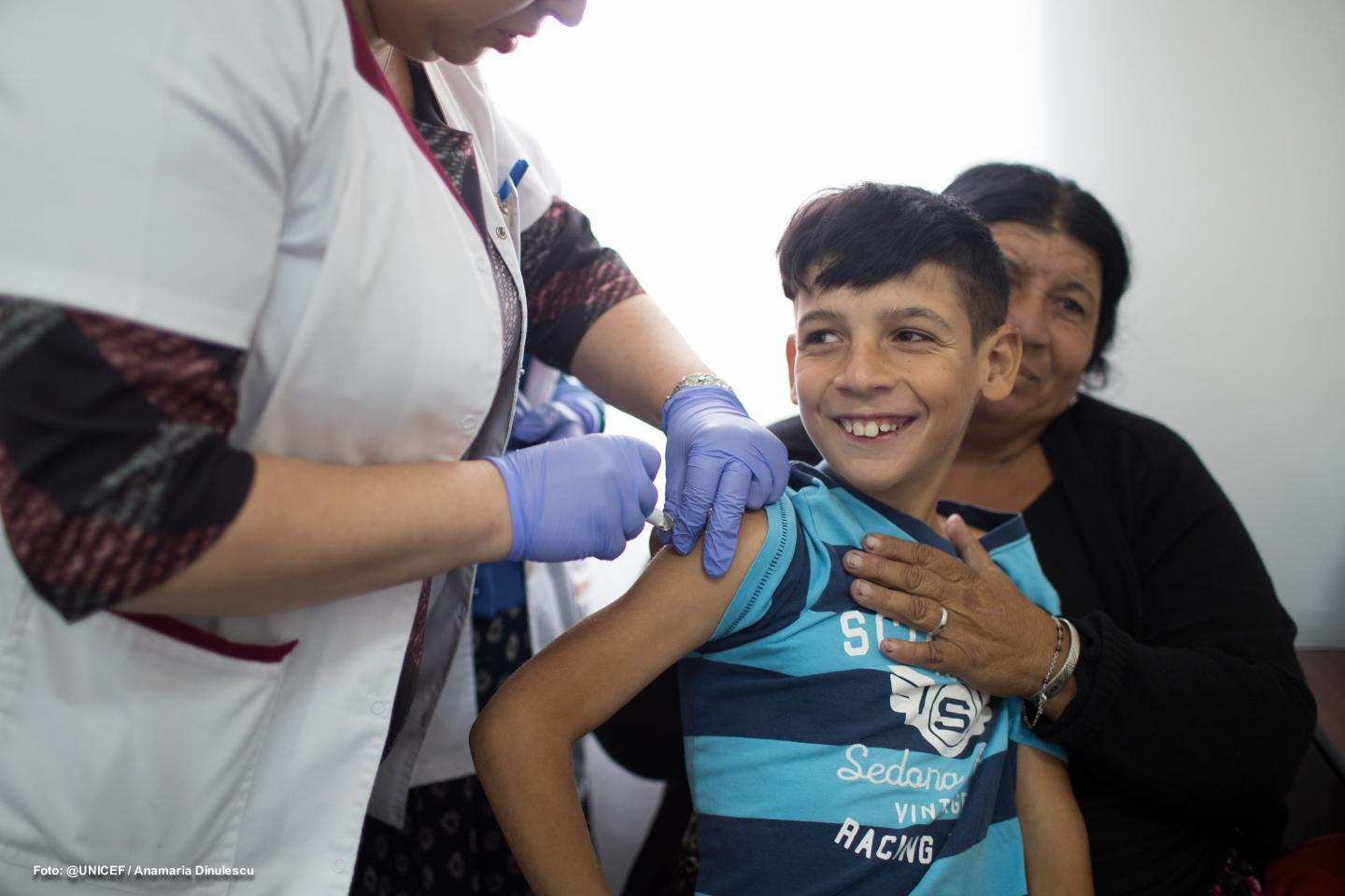 A boy is vaccinated in the town of Strehaia, Southwestern Romania. Children were recently vaccinated during a door-to-door information and vaccination catch up campaign organized by the Ministry of Health with support from UNICEF and the World Health Organization.