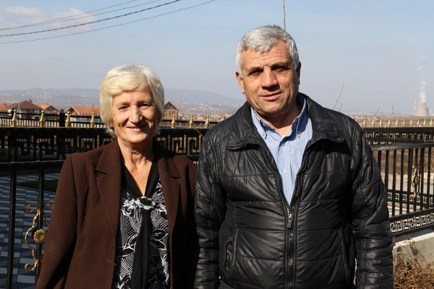 Shaha and Fari standing in front of their house in Fushe-Kosovo.