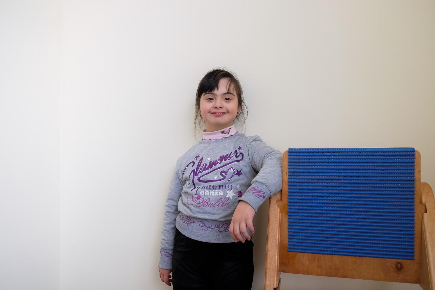 10-year-old Karina who has Down syndrome poses for the camera at the UNICEF-supported community centre for children with disabilities in Borjomi, Georgia.