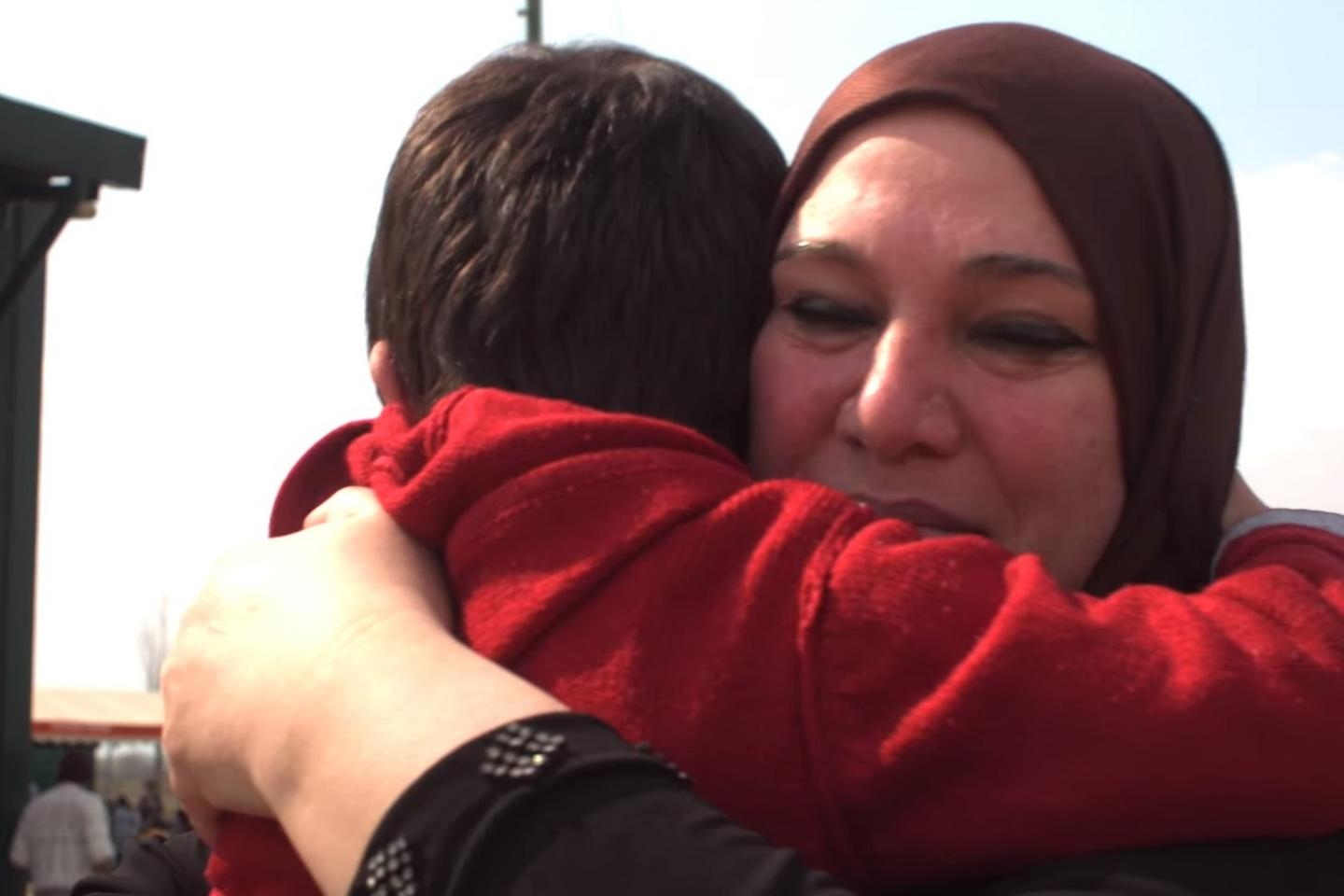 Syrian mother Hanna hugs her son Ahmed at their temporary home in Greece.