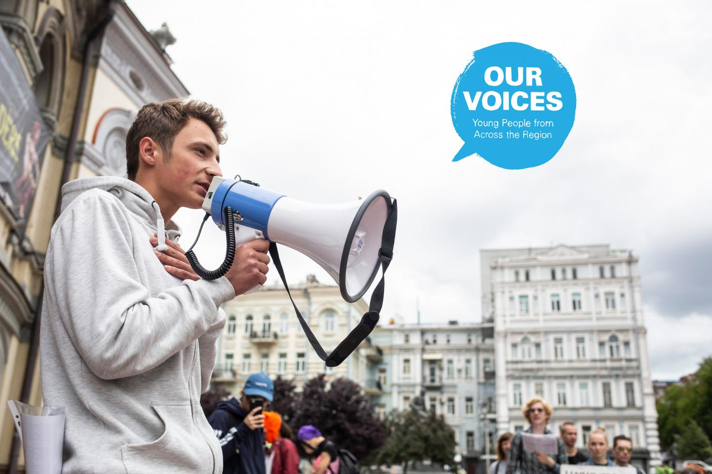 "Dany Stolbunov, 20, born with HIV, speaks on a megaphone during the social protest ""We Want and We Walk"" for the freedom and safety of the mass actions."