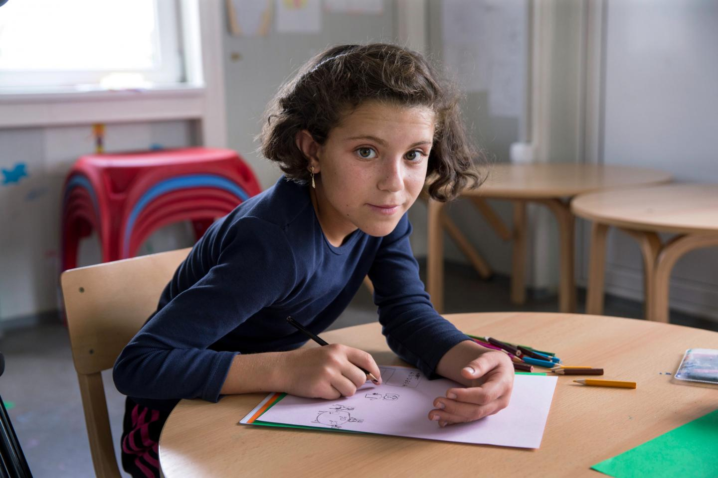Hiba Al Nabolsi a 10 year old Syrian refugee endured an exhausting and risky journey to safety. Here she is in a UNICEF-supported child-friendly space at a refugee and migrant transit centre in the former Yugoslav Republic of Macedonia.