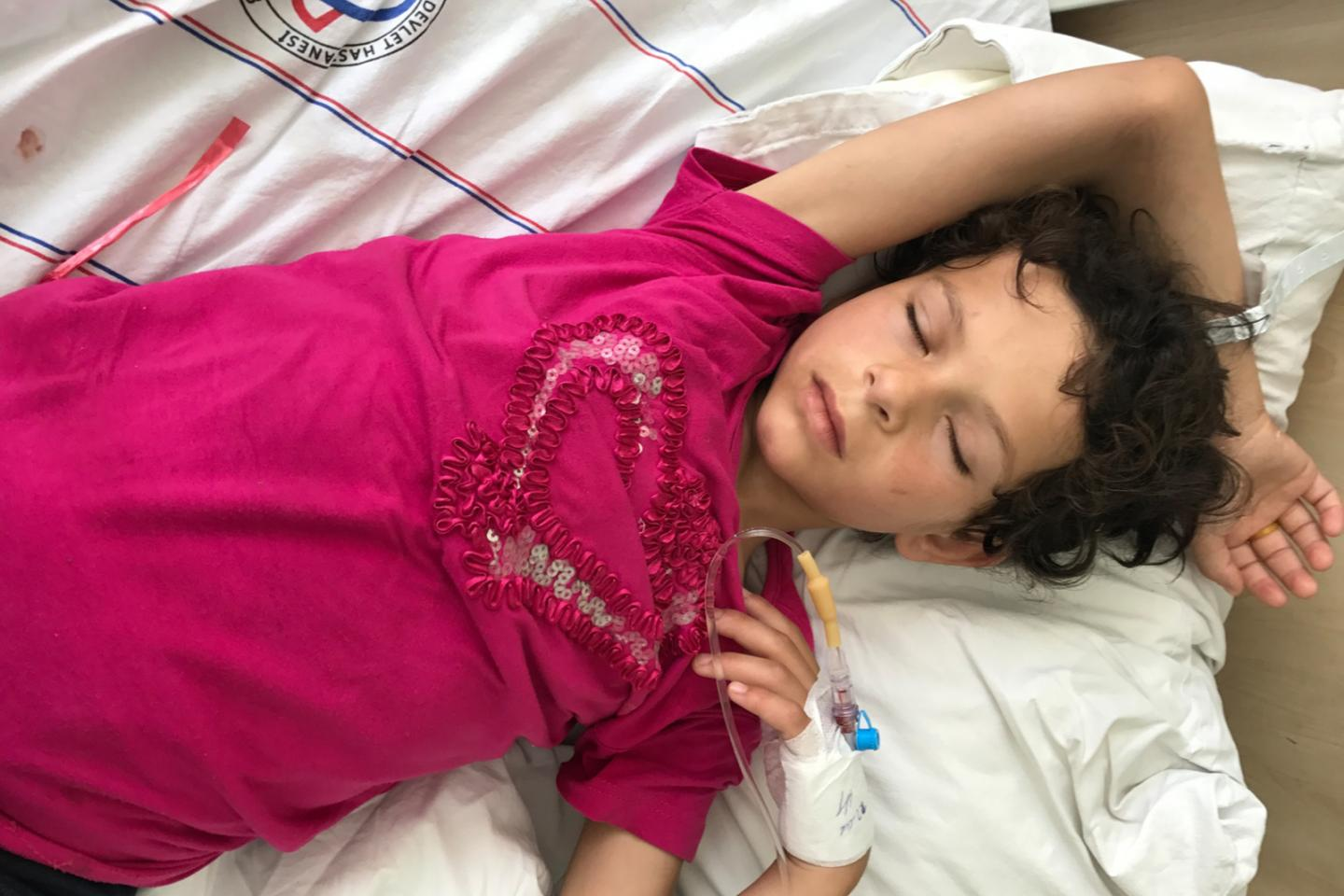 Emine, 7, sleeps in the emergency room at the hospital in Adana, Turkey. She was injured when a bomb hit her family's home in Syria, killing her mother who was pregnant at the time.