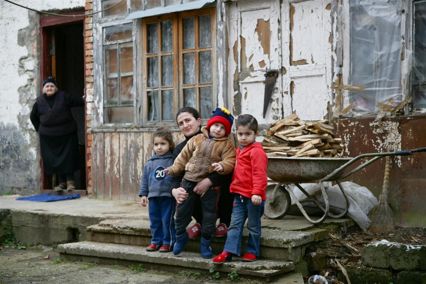 A mother and her three children in Georgia. The family live in extreme poverty but with UNICEF's support they have managed to stay together.