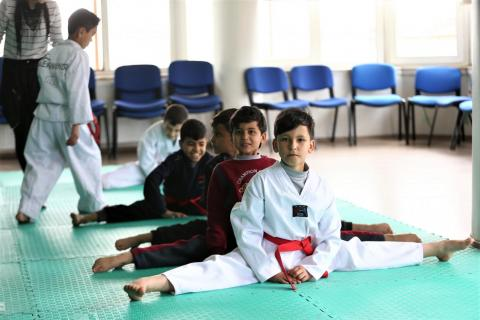 Ali Yasin, 9 years old, at a UNICEF-supported Taekwondo class.