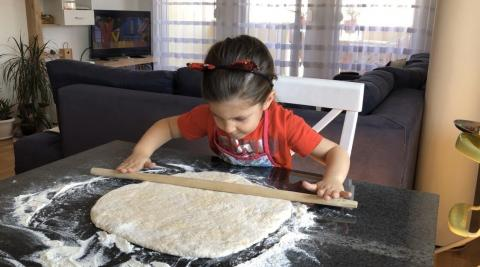 Girl rolling dough