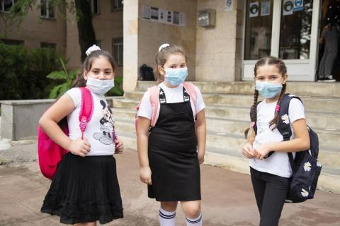 While it is not mandatory for the students to wear masks, many of them — including the youngest among them — were voluntarily covering their faces