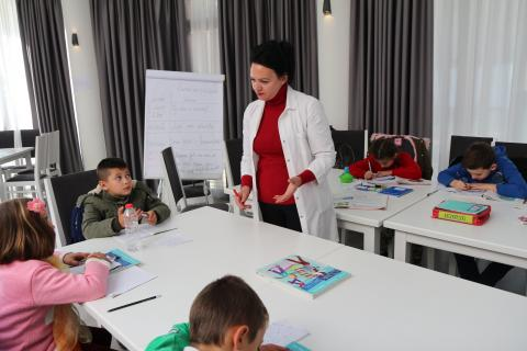 Ms Ervisa teaching language and composition to the children at the temporary learning classes.