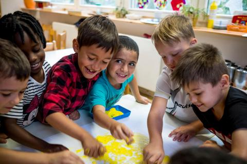 (Centre) Karam Raslan, 5, paints with other children at the Four Seasons Kindergarten, a private kindergarten that does not charge students in Berlin, Germany, Wednesday 6 September 2017.