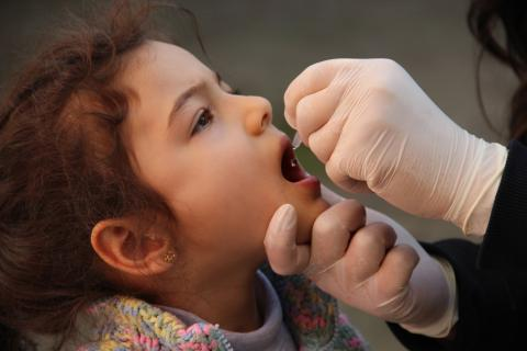 On 20 February 2014 in Turkey, a Syrian girl refugee receives a dose of oral polio vaccine, in Osmaniye Province.