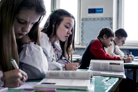 Grade eight students practice reading at secondary school
