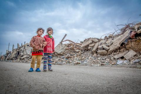 "Noor and Sarah walk in the west of Mosul where many buildings have been totally destroyed. ""I do not know what happened to my father. He's been missing for three months,"" says Nour."