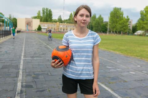 Zhenia, 15 years old, is a goalkeeper and the only girl in the football team. The ball belongs to her older brother, who lives on the other side of the contact line.