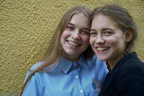 On 16 May 2018 in Belarus, (left-right) Dasha Shlapakova, 15, and Anna Koroleva, 16, both smiling, are participating in activities organized by the local Youth Parliament at the Playgrounds of Gymnasium #3 in the eastern city of Mogilev. Dasha (in the 10th grade) and Anna are both active in the local Youth Parliament, which organizes fun learning activities for students.