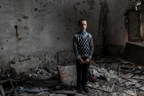 On 23 September 2018 in Ukraine, Yura Khromchenko, 9, stands in the kindergarten class room that took a direct hit from a shell Novotoshkivske in the Luhansk region. The shell caused massive damage to the facility and surrounding residential area.