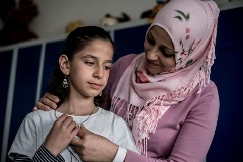 Eleven year old Joudi and her mother Mona from Syria at a refugee shelter in Karlshorst, a suburb of Berlin, Germany.