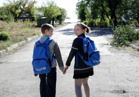 On 23 September 2018 in Ukraine, (left-right) Yura Khromchenko, 9, and Masha Khromchenko, 11 walk down the road in Novotoshkivske in the Luhansk region.