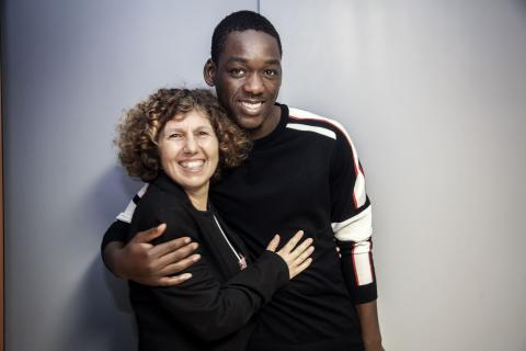 Sidi Soukoula (17) poses with his legal guardian Bernarda 'Benni' Monaco in Palermo, Italy.