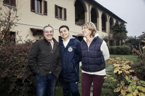 "Mohammad ""Momo"" El Saxed, an 18-year-old Egyptian migrant, with his foster parents in Vittuone, northern Italy."