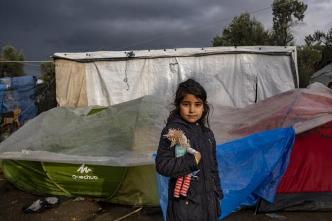 A young girl in front of her tent outside the Reception and Identification Centre in Moria in Lesvos, on December 15, 2018.