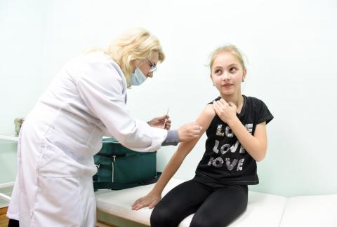 Maryana Dzuba, 9, receives her first dose of MMR vaccine on 21 February 2019 in the medical centre of the Lapaivka village school, Lviv region, Ukraine.